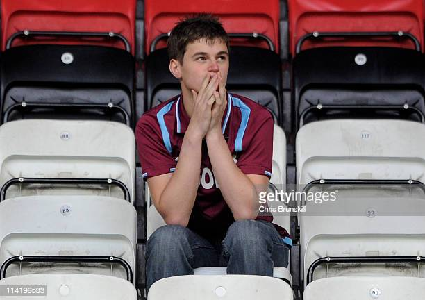 West Ham United fan looks dejected following his team's relegation at the end of the Barclays Premier League match between Wigan Athletic and West...
