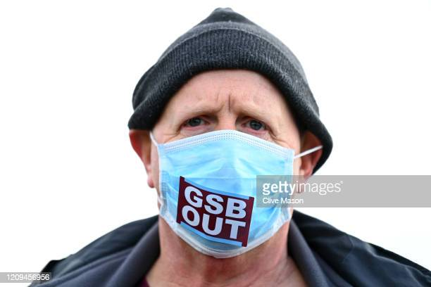 West Ham United fan protests against their owners whilst wearing a mask prior to the Premier League match between West Ham United and Southampton FC...