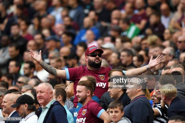 West Ham United fan reacts during the Premier League match between Arsenal FC and West Ham United at Emirates Stadium on August 25 2018 in London...