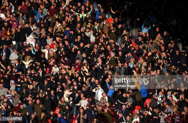 West Ham United fans celebrate their sides first goal during the Premier League match between Manchester United and West Ham United at Old Trafford...