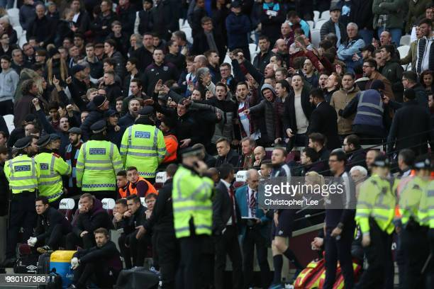 West Ham United fans clash with the police during the Premier League match between West Ham United and Burnley at London Stadium on March 10 2018 in...