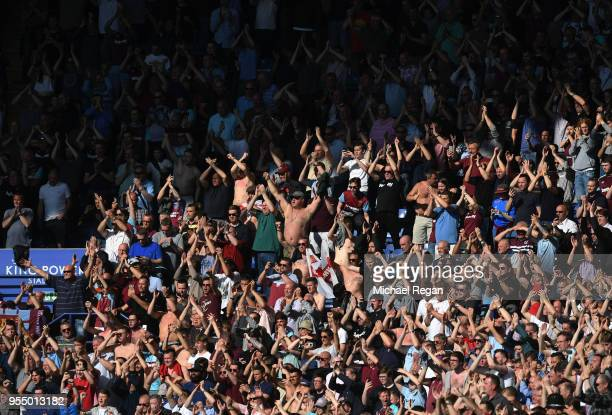 West Ham United fans enjoy the atmosphere during the Premier League match between Leicester City and West Ham United at The King Power Stadium on May...