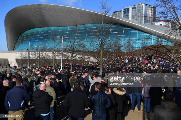 West Ham United fans gather outside the London Stadium to protest against the ownership of the club prior to the Premier League match between West...
