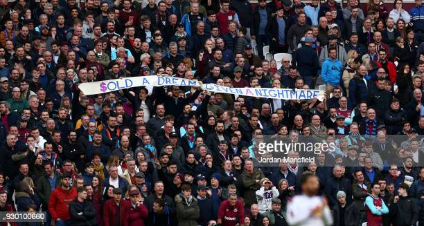 West Ham United fans hold up a protest banner during the Premier League match between West Ham United and Burnley at London Stadium on March 10 2018...