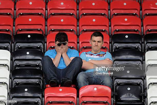 West Ham United fans look dejected following their relegation at the end of the Barclays Premier League match between Wigan Athletic and West Ham...