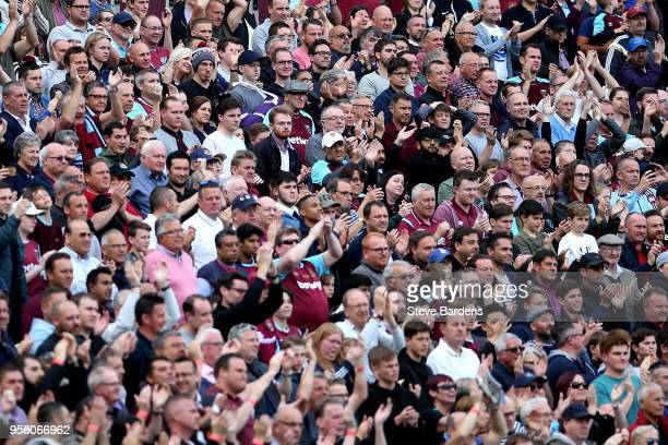 West Ham United fans look on during the Premier League match between West Ham United and Everton at London Stadium on May 13 2018 in London England