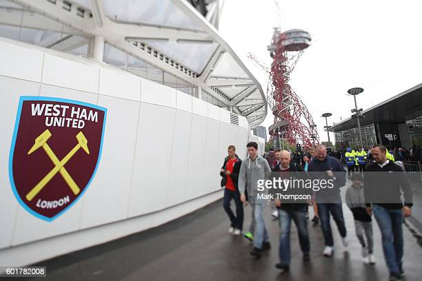 West Ham United fans make their way to the stadiumduring the Premier League match between West Ham United and Watford at Olympic Stadium on September...