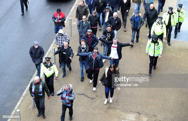 West Ham United fans protest against the West Ham United board escorted by police ahead of the Premier League match between West Ham United and...