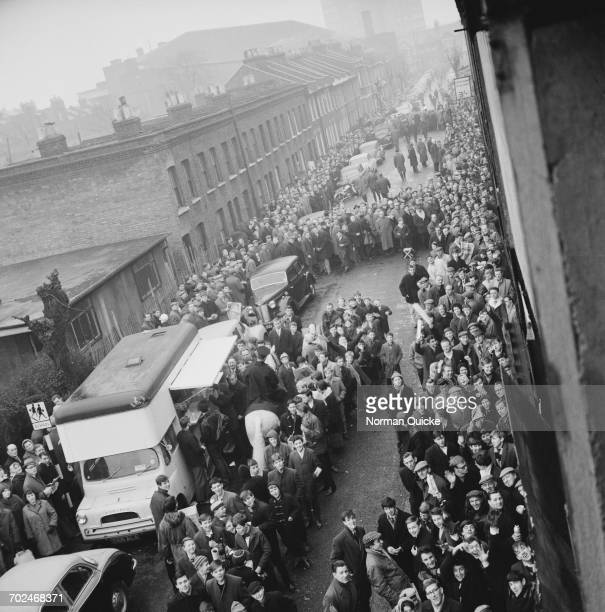 West Ham United fans queuing for match tickets London UK 23rd February 1964