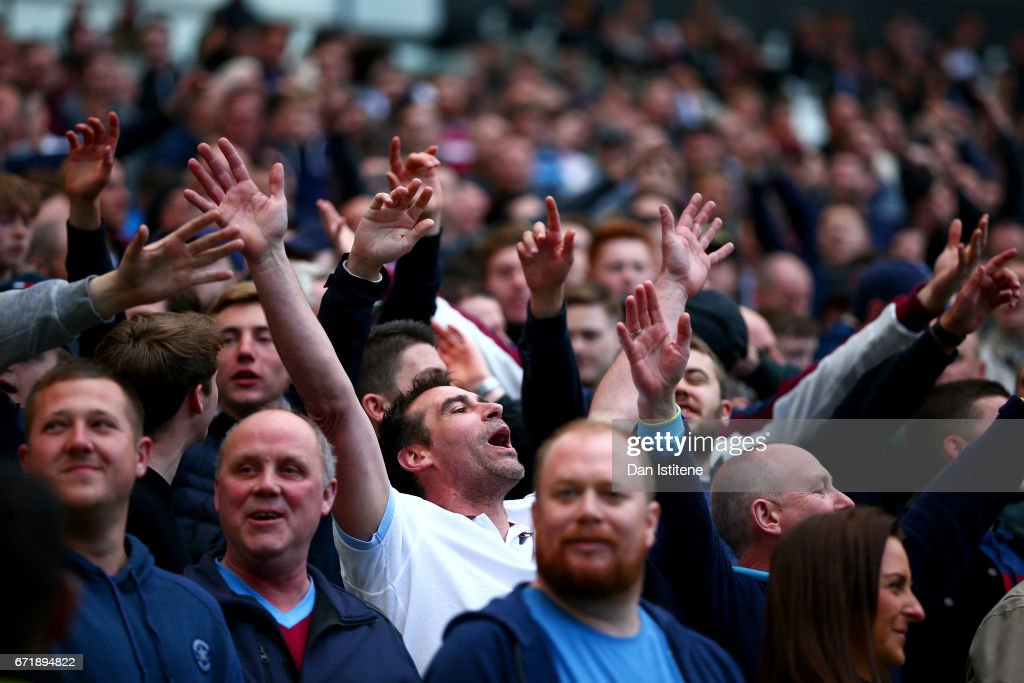 West Ham United fans show their support during the Premier League match between West Ham United and Everton at London Stadium on April 22, 2017 in Stratford, England.