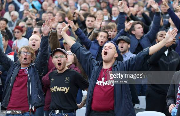 West Ham United fans show their support inside the stadium during the Premier League match between West Ham United and Tottenham Hotspur at London...