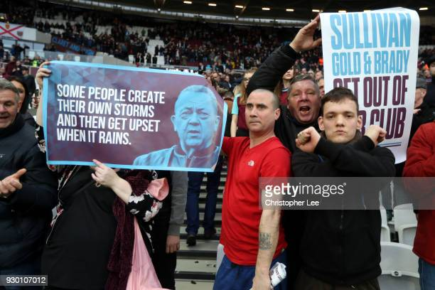 West Ham United fasn hold up protests signs and banners during the Premier League match between West Ham United and Burnley at London Stadium on...