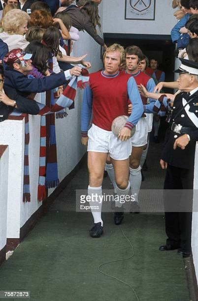 West Ham United FC captain Bobby Moore leads his team out from the tunnel at his team's Upton Park ground London circa 1970 Following Moore is...
