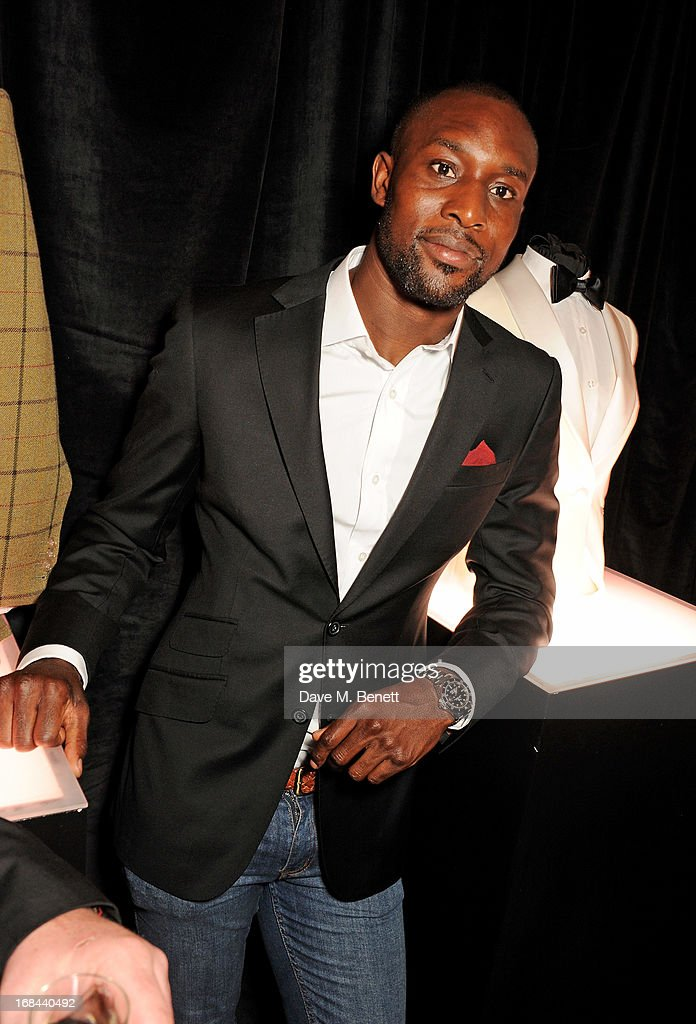West Ham United football player Carlton Cole attend 'A Night of Sporting Gold' hosted by bespoke tailor Apsley at their Pall Mall showroom on May 9, 2013 in London, England.