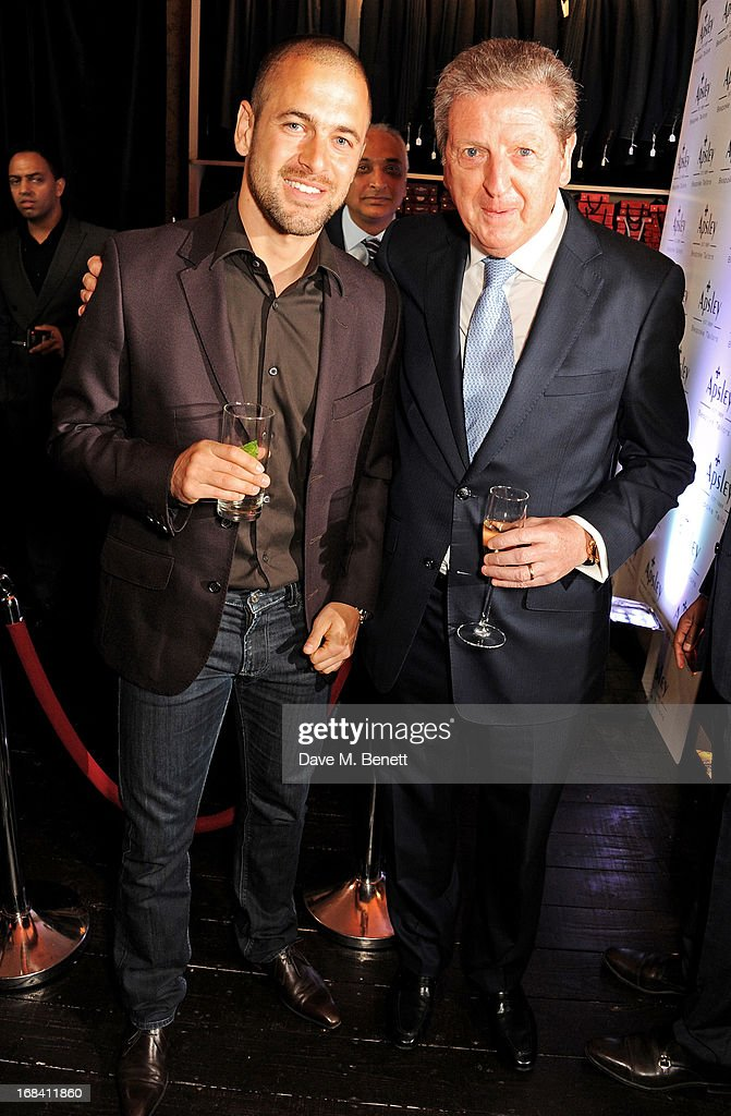 West Ham United football player Joe Cole (L) and England Football Club manager Roy Hodgson attend 'A Night of Sporting Gold' hosted by bespoke tailor Apsley at their Pall Mall showroom on May 9, 2013 in London, England.