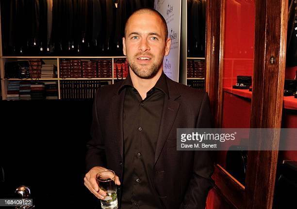 West Ham United football player Joe Cole attends 'A Night of Sporting Gold' hosted by bespoke tailor Apsley at their Pall Mall showroom on May 9 2013...