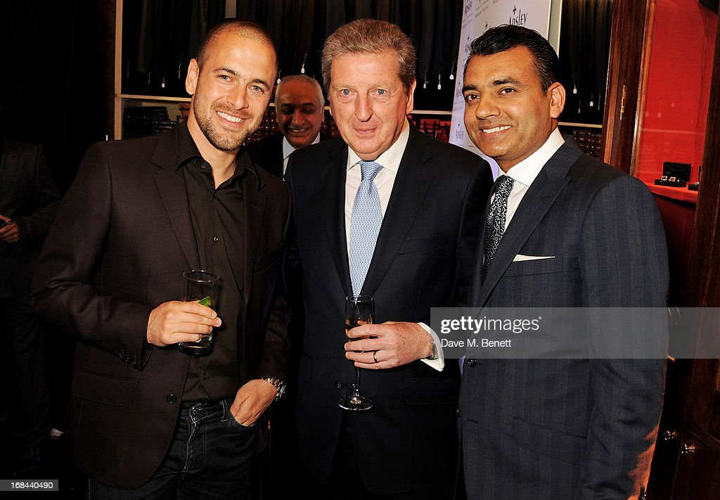 West Ham United football player Joe Cole, England Football Club manager Roy Hodgson and Apsley Manaing Director Arshad Mahmood attend 'A Night of Sporting Gold' hosted by bespoke tailor Apsley at their Pall Mall showroom on May 9, 2013 in London, England.