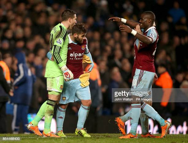 West Ham United goalkeeper Adrian is embraced by teammates Antonio Nocerino and Guy Demel after making a good save