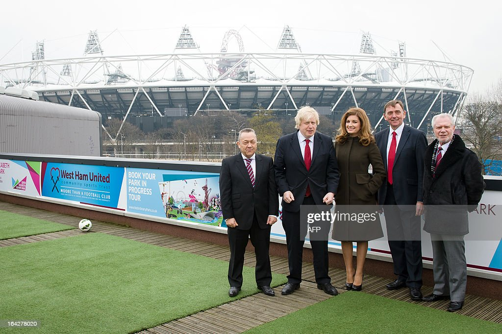 West Ham United joint Chairman Daivd Sullivan, London Mayor Boris Johnson, West Ham United Vice-Chairman Karren Brady, Mayor of Newham Robin Wales and West Ham United joint Chairman David Gold stand in front of the Olympic Stadium following a press conference in east London to announce the new deal between Newham council and West Ham United football club on March 22, 2013. The stadium built for the London 2012 Olympic summer games has had its future secured in a deal where the English Premier League team West Ham United will have a 99 year lease to use the stadium starting in 2016.