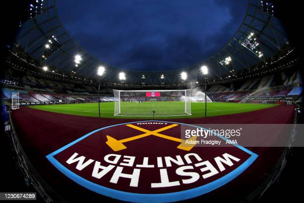 West Ham United logo / badge / crest behind the goals on the pitch at The London Stadium home of West Ham United with floodlights on ahead of the...
