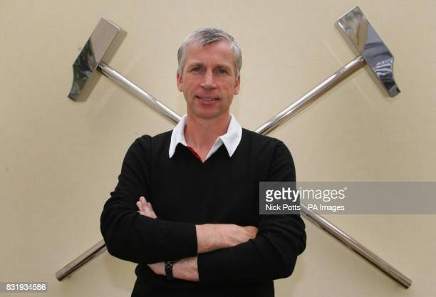 West Ham United manager Alan Pardew stands by the Club crest at the Chadwell Heath Training Ground London