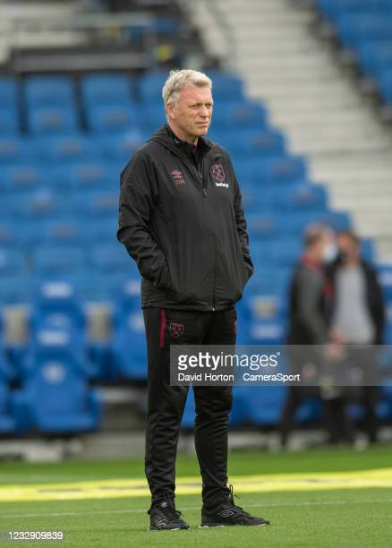 West Ham United manager David Moyes watching the team during the pre-match warm-up during the Premier League match between Brighton & Hove Albion and...