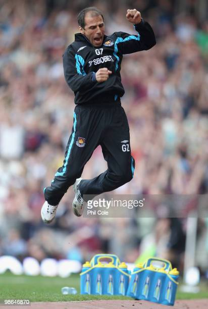 West Ham United manager Gianfranco Zola celebrates his sides third goal during the Barclays Premier League match between West Ham United and Wigan...