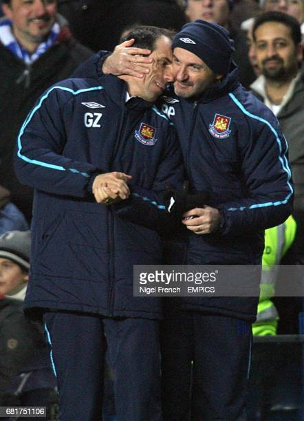 West Ham United manager Gianfranco Zola is congratulated by fitness coach Antonio Pintus on the touchline after the final whistle