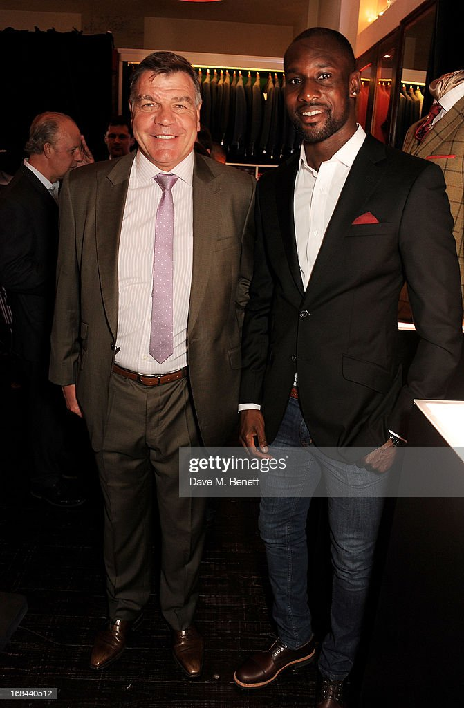 West Ham United manager Sam Allardyce (L) and football player Carlton Cole attend 'A Night of Sporting Gold' hosted by bespoke tailor Apsley at their Pall Mall showroom on May 9, 2013 in London, England.