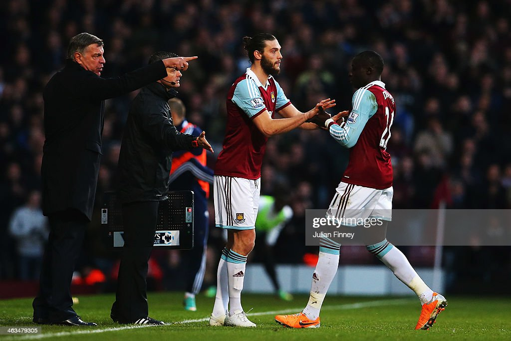West Ham United manager Sam Allardyce sends on Andy Carroll to replace Mohamed Diamé during the Barclays Premier League match between West Ham United and Newcastle United at the Boleyn Ground on January 18, 2014 in London, England.