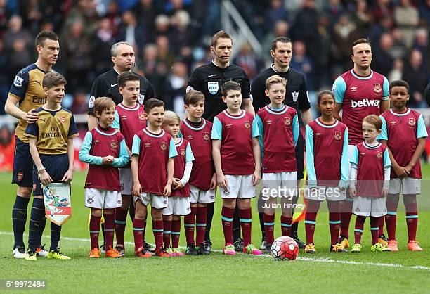West Ham United mascots pose for photographs prior to the Barclays Premier League match between West Ham United and Arsenal at the Boleyn Ground on...