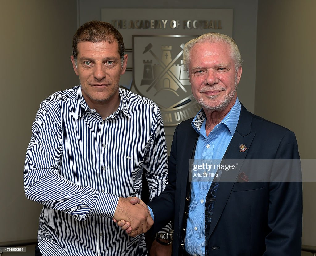 West Ham United New Manager Slaven Bilic shakes hands with West Ham Chairman David Gold at the Boleyn Ground on June 12, 2015 in London, United Kingdom.