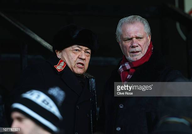 West Ham United owners David Sullivan and David Gold look on prior to the Barclays Premier League match between Fulham and West Ham United at Craven...