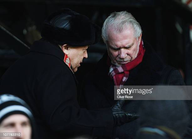 West Ham United owners David Sullivan and David Gold talk prior to the Barclays Premier League match between Fulham and West Ham United at Craven...