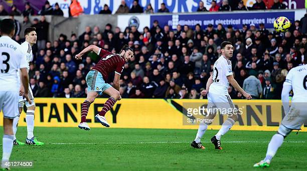 West Ham United player Andy Carroll shoots to score the opening goal during the Barclays Premier League match between Swansea City and West Ham...
