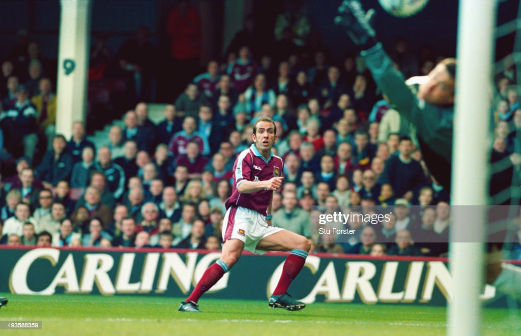 West Ham United player Paolo Di Canio fires in the first goal past Neil Sullivan during the FA Carling Premiership match between West Ham United and Wimbledon at Upton Park on March 26, 2000 in London, England. West Ham won the game 2-1 and Di Canio's goal was voted goal of the season.