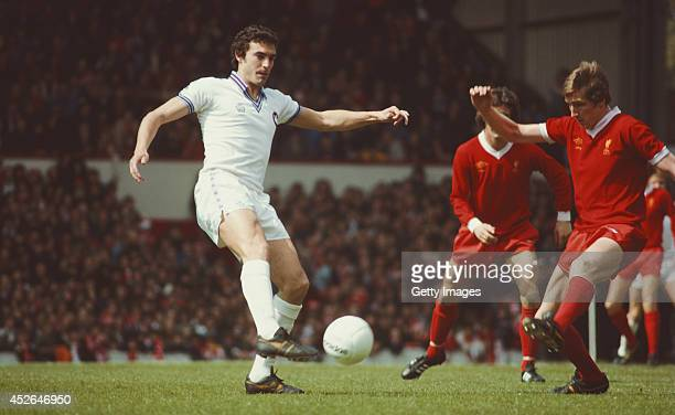 West Ham United player Trevor Brooking is challenged by Jimmy Case of Liverpool during a Division One match between Liverpool and West Ham at Anfield...