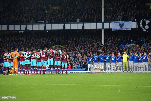 West Ham United players and Everton players pay their tributes in a minutes silence for the fallen during the Premier League match between Everton...