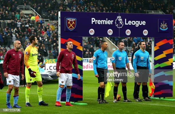 West Ham United players and match officials line up in front of branding for the This Is Everyones Game campaign prior to the Premier League match...