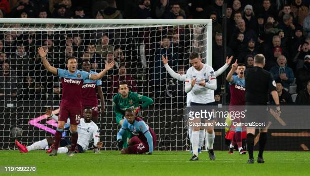 West Ham United players appealing to Referee Jonathan Moss during the Premier League match between West Ham United and Liverpool FC at London Stadium...