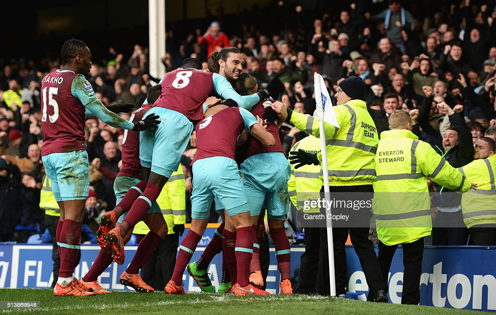 West Ham United players celebrate their third goal by Dimitri Payet (obscured) during the Barclays Premier League match between Everton and West Ham United at Goodison Park on March 5, 2016 in Liverpool, England.