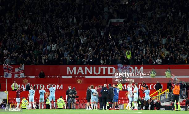 West Ham United players celebrate with their fans after their sides victory in the Carabao Cup Third Round match between Manchester United and West...
