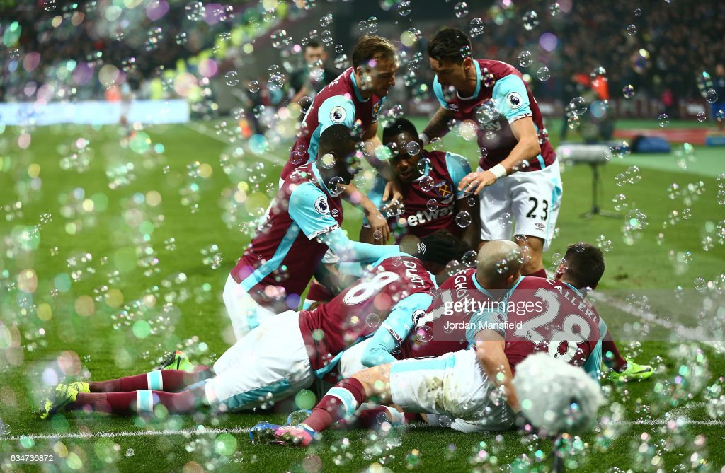 West Ham United players celebrates their team's second goal by Manuel Lanzini (obscured) during the Premier League match between West Ham United and West Bromwich Albion at London Stadium on February 11, 2017 in Stratford, England.