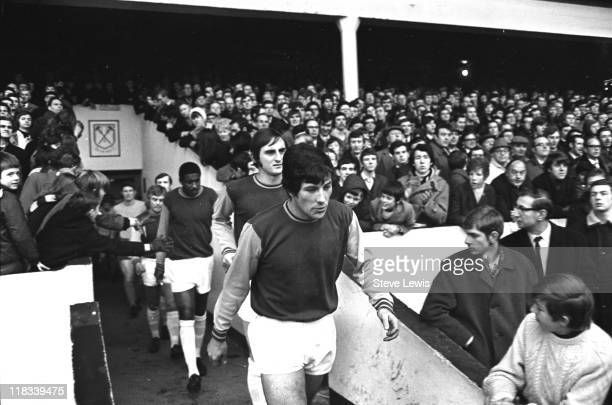 West Ham United players enter the pitch at West Ham Football Club at Upton Park Newham East London circa 1970