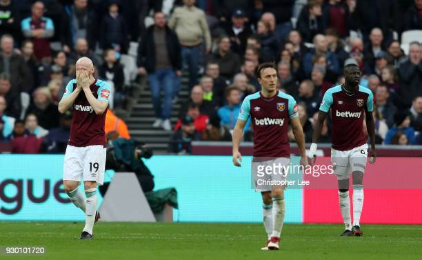 West Ham United players look dejected during the Premier League match between West Ham United and Burnley at London Stadium on March 10 2018 in...