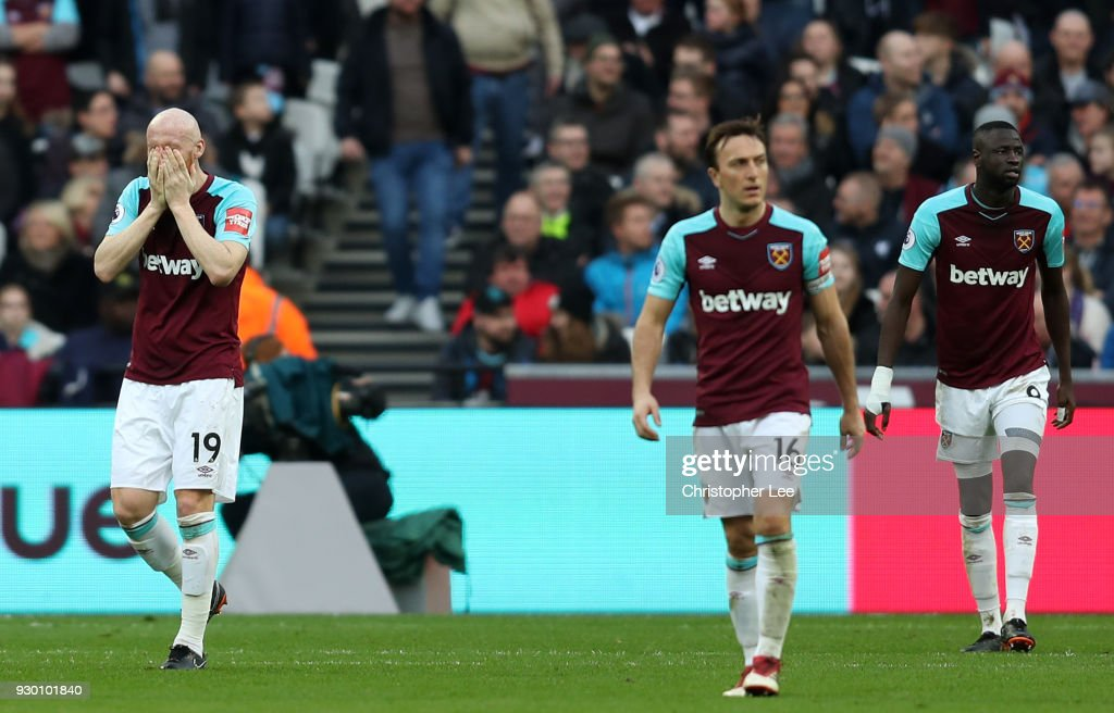 West Ham United players look dejected following Burnley's third goal during the Premier League match between West Ham United and Burnley at London Stadium on March 10, 2018 in London, England.