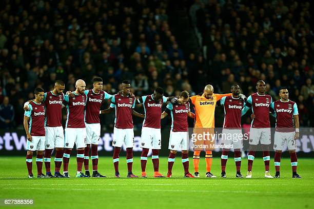 West Ham United players observe a minutes silence for the victims of the plane crash involving the Brazilian club Chapecoense prior to the Premier...