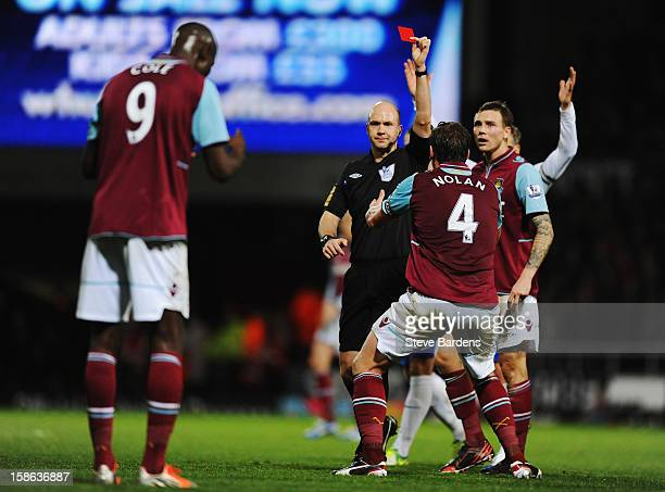 West Ham United players react as match referee Anthony Taylor sends off Carlton Cole of West Ham United for a high tackle during the Barclays Premier...