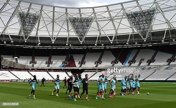 West Ham United players warm up during their training session at Queen Elizabeth Olympic Park on August 3 2016 in London England