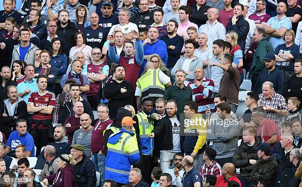 West Ham United stewards attempt to calm down some fans during the Premier League match between West Ham United and Middlesbrough at London Stadium...